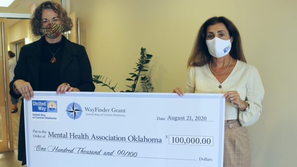 United Way of Central Oklahoma President and CEO, Debby Hampton, awarding Mental Health Association's MJ Clausen the WayFinder Innovation Grant